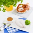 Weisswurst white sausages and sweet mustard with pretzel - Stock Photo