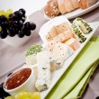 Cheese plate with grapes and wine dinner - Stockfoto