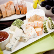 Cheese plate with grapes and wine dinner - Stock Photo