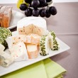 Cheese plate with grapes and wine dinner — Stock Photo #22094901