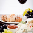 Cheese plate with grapes and wine dinner — Stock Photo #22094953