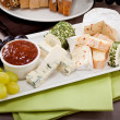 Cheese plate with grapes and wine dinner — Stock Photo #22095121