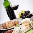 Cheese plate with grapes and wine dinner — Stock Photo