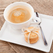 Fresh aromatic coffee and cookies on table — Stock Photo