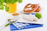 Weisswurst white sausages and sweet mustard with pretzel — Stock Photo