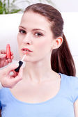 Woman applying lipstick on lips natural beauty — Stock Photo