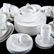 Mixed white dishes cups and plates isolated on black — Stock Photo