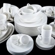 Mixed white dishes cups and plates isolated on black — Stock Photo #22410915