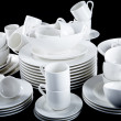 Royalty-Free Stock Photo: Mixed white dishes cups and plates isolated on black