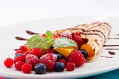 Fresh tasty homemade crepe pancake and fruits — Stock Photo
