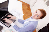 Young successful business woman in office — Stock Photo
