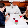 Happy couple in restaurant romantic date — Stock Photo #24132101
