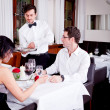 Waiter serve fresh espresso for happy couple — Foto de stock #24136517