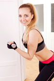 Attractive young woman doing fitness dumbbell — Stock Photo