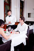 Waiter serve fresh espresso for happy couple — Stock Photo