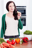 Young woman cooking vegetarian food — Stock Photo