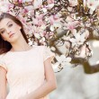 Stock Photo: Beautiful young womand pink magnolia