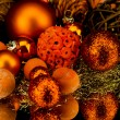Christmas decoration in orange on black - Stock Photo