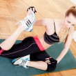 Attractive young woman doing workout stretching — Zdjęcie stockowe