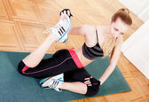 Attractive young woman doing workout stretching — Stock Photo