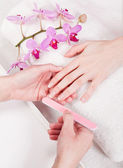 Manicure making in beauty spa salon — Stock Photo