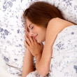 Stock Photo: Young brunette woman lying in bed sleeping morning