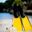 Yellow fins and snorkelling mask on beach in summer — Stock Photo