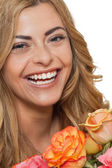 Attractive young smiling woman with flowers roses isolated — Stock Photo