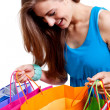 Attractive young woman with colorful shopping bags isolated — Stock Photo #28122391