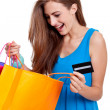 Happy young woman with colorful shopping bags visa isolated — Stock Photo #28122461