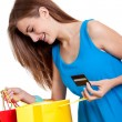 Happy young woman with colorful shopping bags visa isolated — Stock Photo