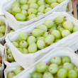 Fresh tasty gooseberries macro closeup on market outdoor — Stock Photo #28128225