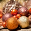 Glittering christmas decoration in orange and brown natural wood — ストック写真