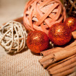 Glittering christmas decoration in orange and brown natural wood — Stock Photo