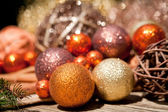 Glittering christmas decoration in orange and brown natural wood — Стоковое фото