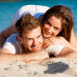 Young happy couple in summer holiday vacation summertime — Stock Photo #28950091