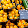 Fresh tasty yellow cherry tomatoes macro closeup on market — Stock Photo