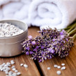 Fresh lavender white towel and bath salt on wooden background — Stock Photo