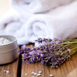 Fresh lavender white towel and bath salt on wooden background — Stock Photo #28959335