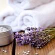 Fresh lavender white towel and bath salt on wooden background — Stock Photo