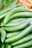Fresh green cucumber on market macro — Stock Photo