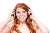 Attractive happy woman with headphones listen to music isolated — Stock fotografie