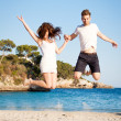 Stock Photo: Happy young couple having fun in summer holiday vacation