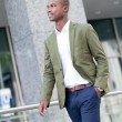 Stock Photo: Young successful african business man outdoor in summer