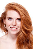 Beautiful young redhead woman with freckles portrait — Stock Photo