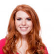 Young smiling redhead woman portrait isolated expression — Stock Photo