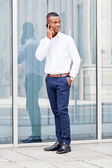 Young successfil african businessman with mobilephone — Stock Photo