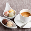 Sweet delicious truffle pralines chocolate and hot espresso coffee — Stock Photo