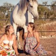 Two woman horse and dog outdoor in summer happy — Stock Photo