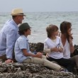 Stock Video: Happy family sitting on a beach